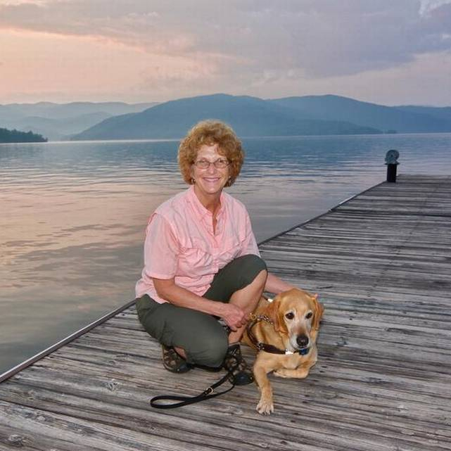 Ann and Brego on a fishing pier at Lake Jocassee at sunset.